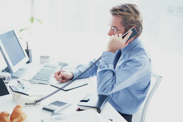 business_man_beside_telephone02