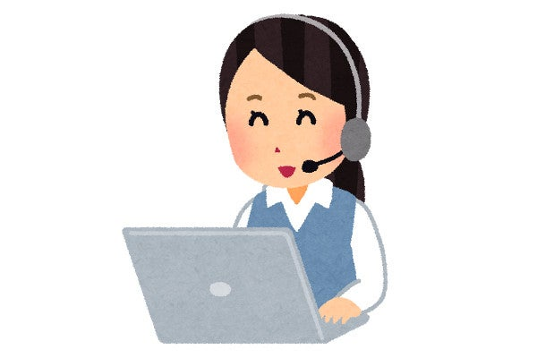 電話営業を行う女性